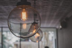 glass pendants with edison bulb; highlighting natural lighting elements