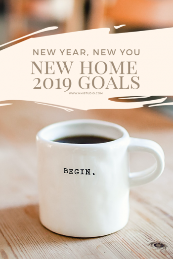 "image of white mug with black ""begin."" written on it, sitting on wood table, with warm colors. text says new year, new you, new home 2019 goals"